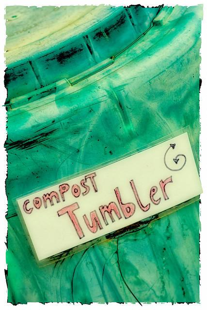 green compost tumbler labeled as compost tumbler