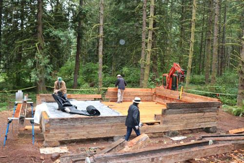 The Molalla Log House is being reassembled near a walking trail by newly constructed ponds  t Hopkins Demonstration Forest.
