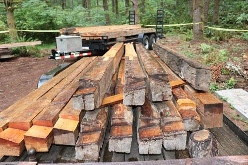 Hand-hewn Douglas-fir logs stack tightly together to without gaps to keep out the weather.