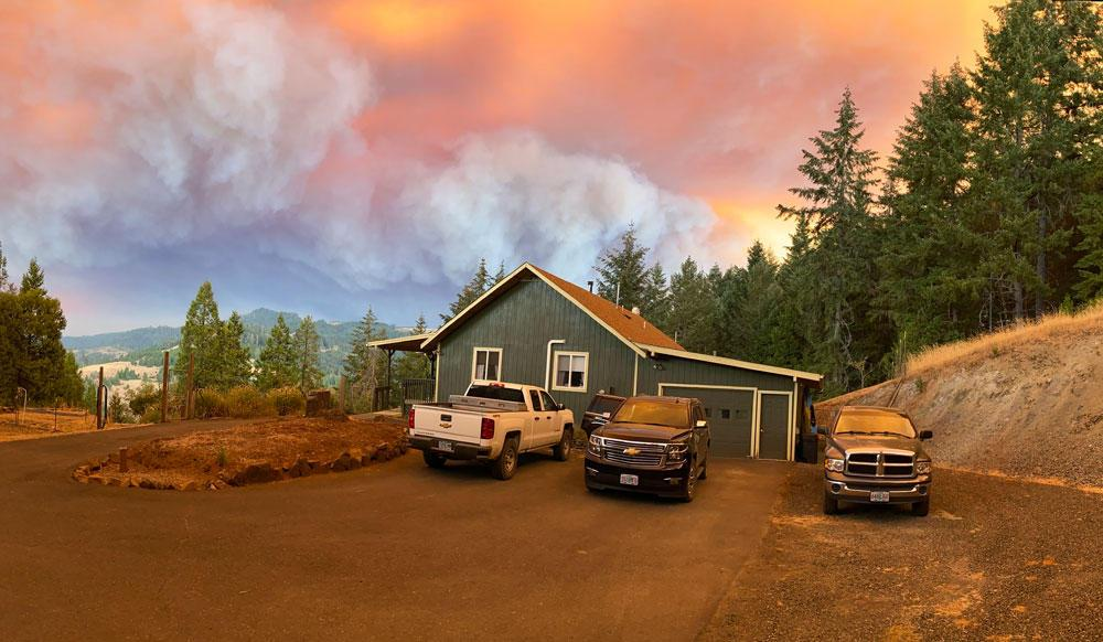 Smoke fills the sky above Alicia Christiansen's home in Glide, Oregon, on Sept. 8.