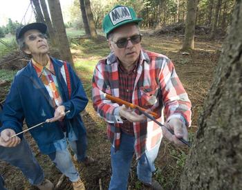 OSU Extension Master Woodland Manager volunteers Dave Hill and Vera Watson extract tree core samples.
