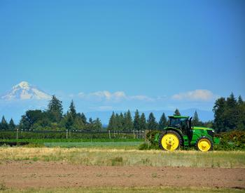 tractor and plowed field at NWREC