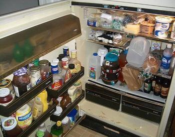 Refrigerator full of food and condiments