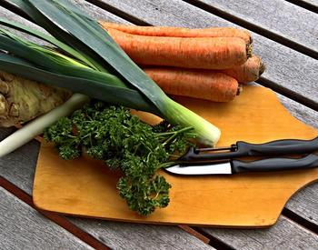 Leeks, parsley, and carrots on cutting board
