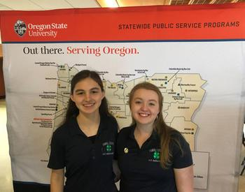 Yamhill County 4-H members Kaylani Kam (left) and Abby Bohnam