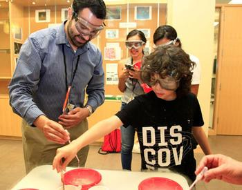 Child and adult activity during STEM camp through Open Campus