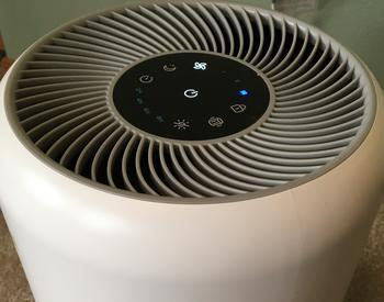 Portable indoor air cleaner shown operating at highest speed
