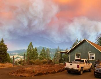Smoke from wildfires over a house