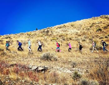 The members of the Lake County 4-H Hiking Club line a trail in the foothills of the Warner Mountains above Lakeview.